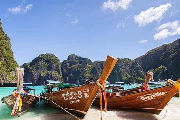 A beautiful beach with boats in Thailand