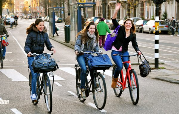 Women Cycling In Amsterdam