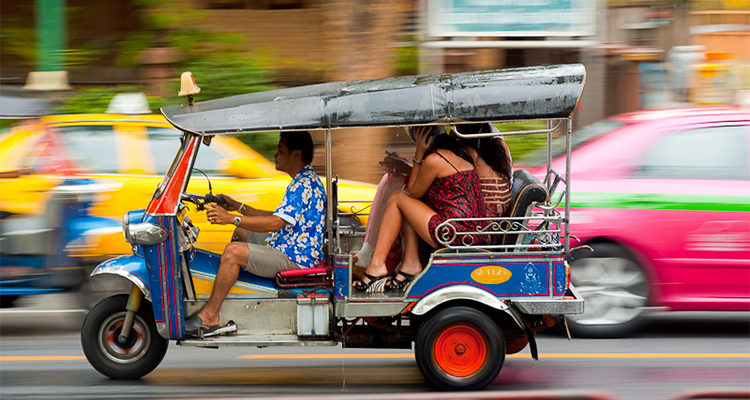 Thailand: A tuk-tuk in Bangkok traffic