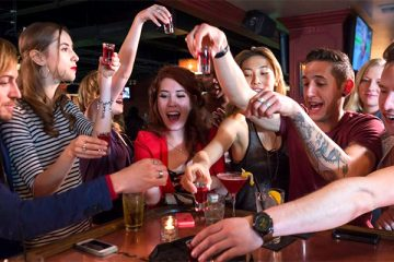 twenties drinking in bar